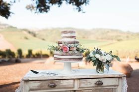 3 three tier naked wedding cake fresh flowers pink blue purple green natural