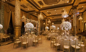 wedding reception in the drake hotel gold coast room with tall floral centerpieces