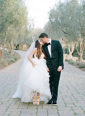 Adam Ottavino in bow tie with wife on wedding day in Vera Wang wedding dress Charlotte Olympia shoes