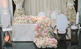 floral runner that spills onto floor white pink hydrangea, rose, peony, ranunculus flowers