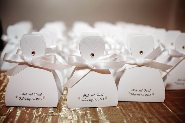 Favor boxes in shape of bridal gown with ribbon and pearls
