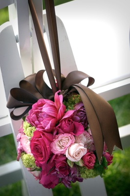 Pink and green flower ball hung with brown ribbon