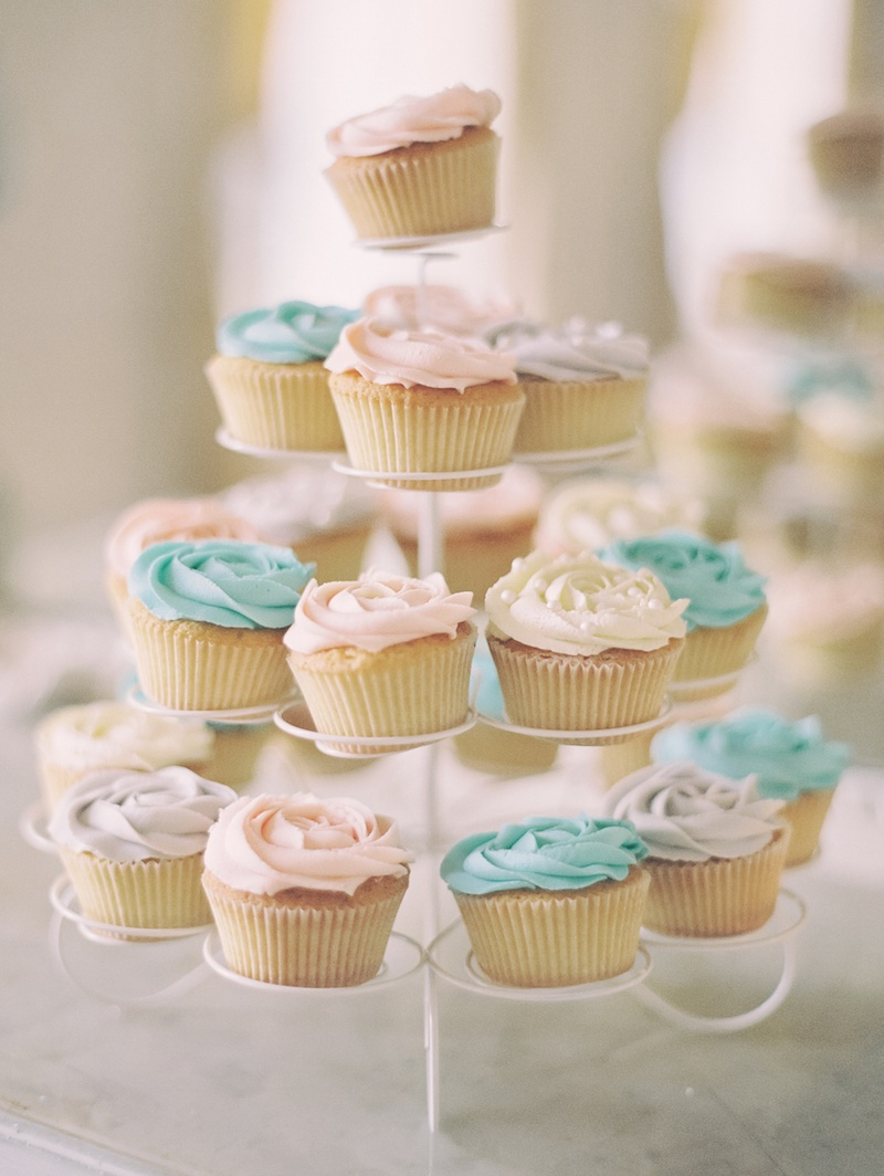 Wedding cupcakes topped with white, blue and pink frosting