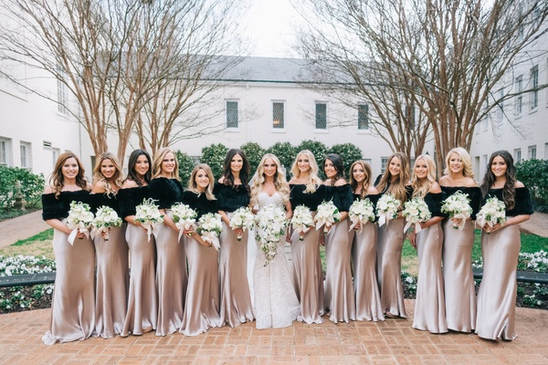 Wedding party lots of bridesmaids satin dresses with black off shoulder fur stoles winter wedding