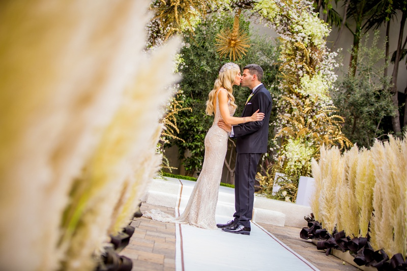 pampas grass along aisle, art deco inspired wedding, elaborate chuppah