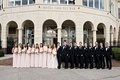 Wedding party pink bridesmaid dresses groomsmen in tuxedos in front of Casa Del Mar in Santa Monica