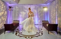 model bride twirling designer gown pallas couture australian bridal shop plunging neckline overskirt
