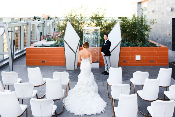wedding ceremony on rooftop of intercontinental hotel downtown LA, geometric columns, fountain