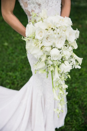 white cascading bridal bouquet with roses and calla lilies