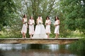 Pale pink bridesmaid dresses on Wyoming bridge