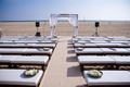 Wood bench ceremony seating for beach wedding