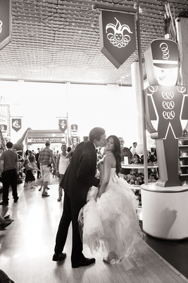 black and white photo of bride and groom at fao schwartz in new york city