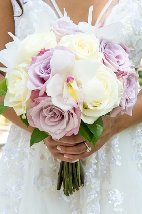 ivory, blush, pale lavender roses in bridal bouquet, statement orchid in bridal bouquet