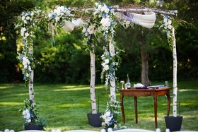 chuppah of white braces and greenery