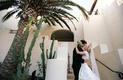 Bride in Monique Lhuillier wedding dress with groom