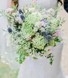 bride natural wildflower bouquet daisies thistles greenery pink blue english british wedding