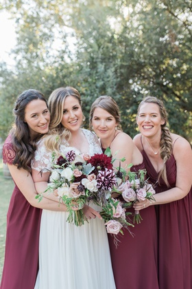 bride in jina couture bridal gown, lace short sleeves, bridesmaids in marsala