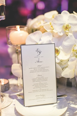 White dinner menu with monogram and silver border