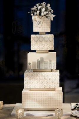 wedding cake with houndstooth and argyle pattern layers chicago skyline bow cake topper