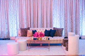 Dancing ballroom wedding space with tufted sofa, blue pillow, leopard print pillows