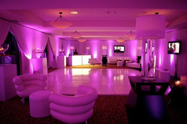 Purple and pink lighting in after party ballroom