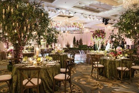 Seasonally inspired decor warms guests to the idea of spring at a luxe winter wedding.