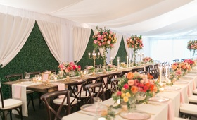 tented wedding with hedge wall and drapery