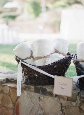 White wedding throw blanket wrapped with burlap ribbon
