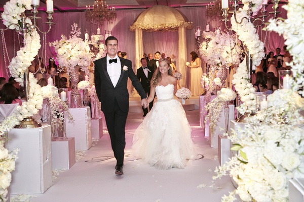 Couple walking on monogrammed aisle runner