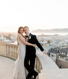 james leary flood mansion san francisco wedding, bride and groom on balcony overlooking san francisc