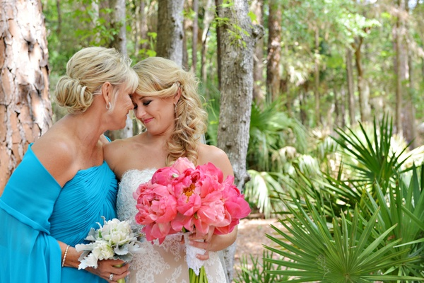 Bride in lace Anne Barge gown with mother ins a strapless light blue dress