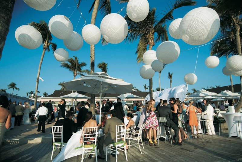 round white paper lanterns hung above outdoor reception