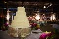 White wedding cake covered in white beads