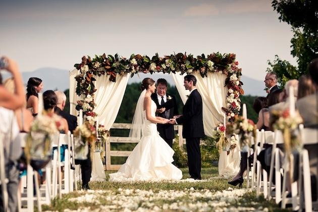 Bride and groom at alfresco wedding ceremony