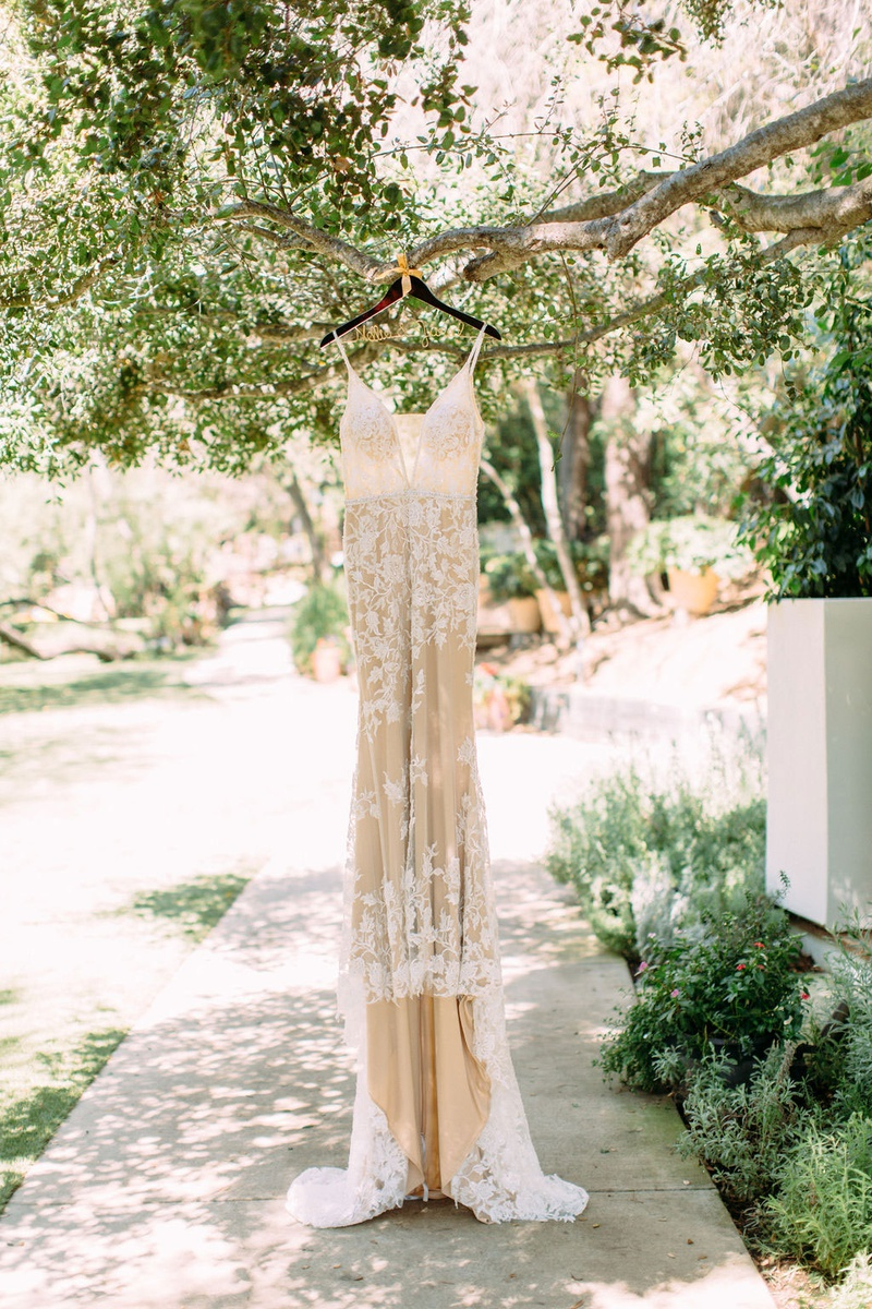 Calla Blanche wedding dress v neck spaghetti strap lace embellishments nude underlay hanging tree