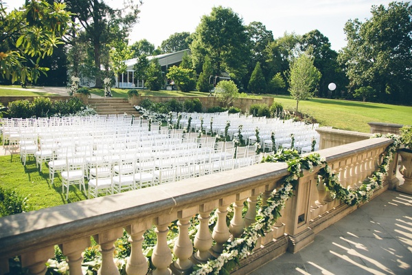 Garlands of greenery on stone balcony pillars