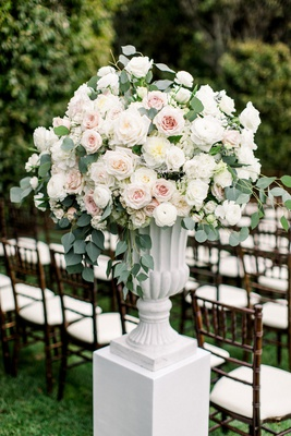 white riser white urb vase blush pink and white rose eucalyptus outdoor ceremony decorations flowers