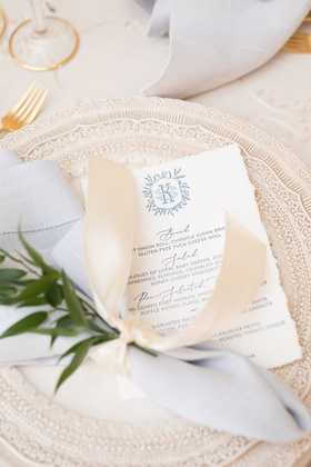wedding reception charger plate with white torn edge menu monogram blue grey script napkin ribbon