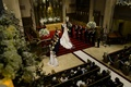 Bride and groom at altar steps of classic church with white flowers