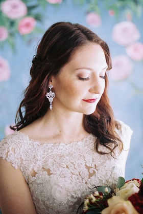 beauty beast movie styled wedding shoot princess belle red lips crystal earrings model soft feminine