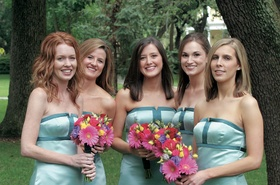 Teal bridesmaid gowns with colorful bouquets
