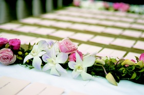 Pink rose and white orchid garland for wedding reception place card table