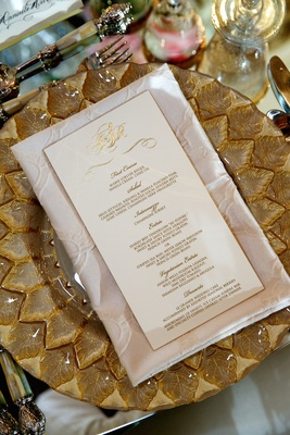 Ivory and gilt dinner menu with couple's monogram