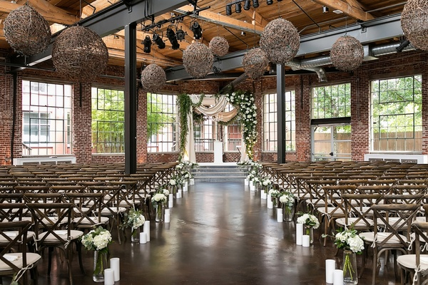 the foundry at puritan mill wedding, dark wooden & brick ceremony space, vineyard chairs