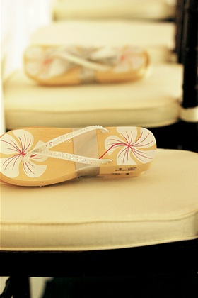 Flip flops tied with ribbon waiting on guest chairs
