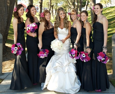 Bride with bridesmaids holding fuchsia bouquets