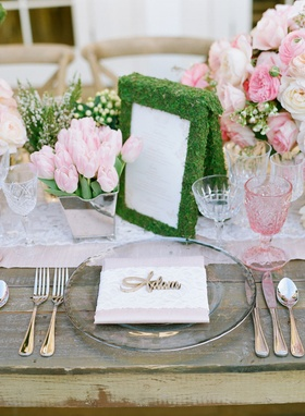 Laser-cut name on glass charger plate with pink and lace runner moss covered menu pink tulip rose