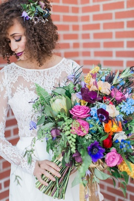 large arm bouquet with colorful garden roses, ranunculus, anenomes, hellebora, clematis, maidenhair