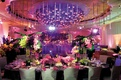 Purple wedding reception lighting and large ceiling treatment