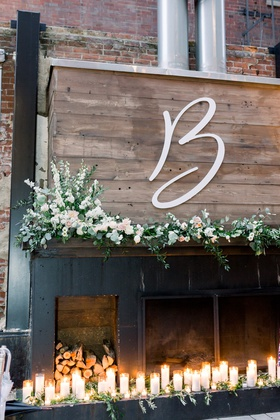 large cutout monogram on wood, florals, candles